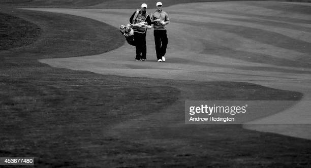 Oliver Fisher of England walks with his caddie Justin Grenfell Hoyle on the fourth hole during the third round of the Made In Denmark at Himmerland...