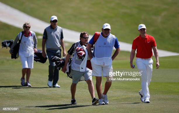 Oliver Fisher of England walks with the caddies on the 1st hole during day three of the NH Collection Open held at La Reserva de Sotogrande Club de...