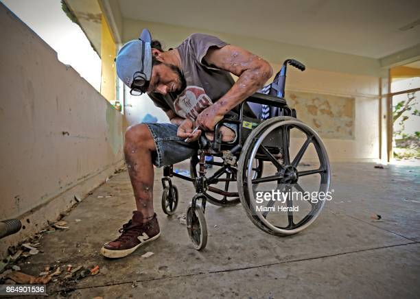 Oliver Franco Rivero injects himself with heroine and cocaine at an abandoned school in Cidra Puerto Rico on October 19 2017