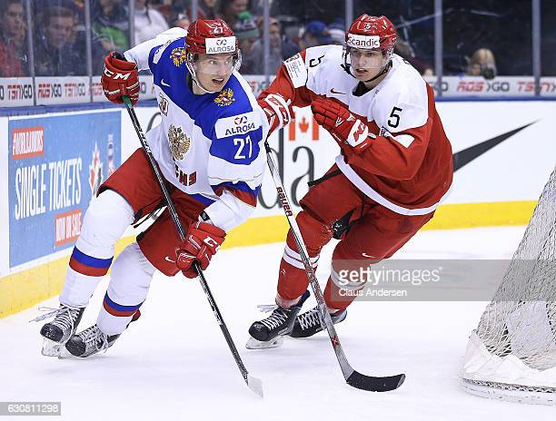 Oliver Gatz of Team Denmark skates against Denis Guryanov of Team Russia during a QuarterFinal game at the 2017 IIHF World Junior Hockey...