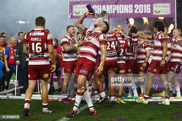 Oliver Gildart of Wigan celebrates his sides 126 victory with a bottle of champagne during the First Utility Super League Final between Warrington...