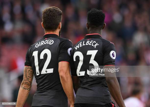 Oliver Giroud and Danny Welbeck of Arsenal during the Premier League match between Stoke City and Arsenal at Bet365 Stadium on August 19 2017 in...