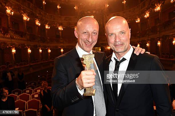 Oliver Hirschbiegel and Christian Berkel attend the Bernhard Wicki Award 2015 during the Munich Film Festival at Cuvilles Theatre on July 2 2015 in...