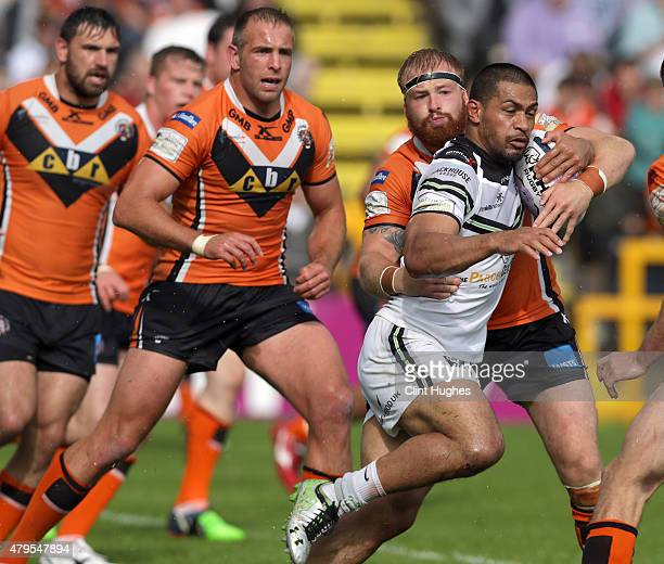 Oliver Holmes of Castleford Tigers tackles Willie Isa of Widnes Vikings during the First Utility Super League match between Castleford Tigers and...