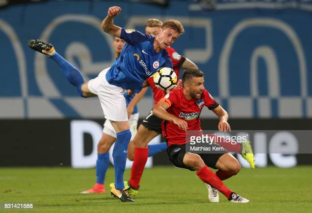 Oliver Huesing of Rostock battles for the ball with Vedad Ibisevic of Berlin during the DFB Cup first round match between FC Hansa Rostock and Hertha...