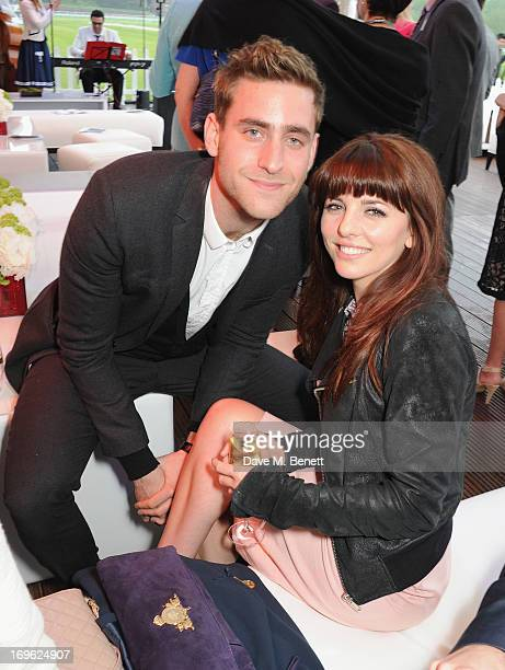 Oliver JacksonCohen and Ophelia Lovibond attend at the Audi Royal Polo Challenge 2013 at Chester Racecourse on May 29 2013 in Chester England