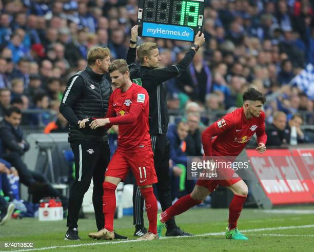 Oliver Jasen Burke of Leipzig shakes hands with Timo Werner of Leipzig during the Bundesliga match between FC Schalke 04 and RB Leipzig at...