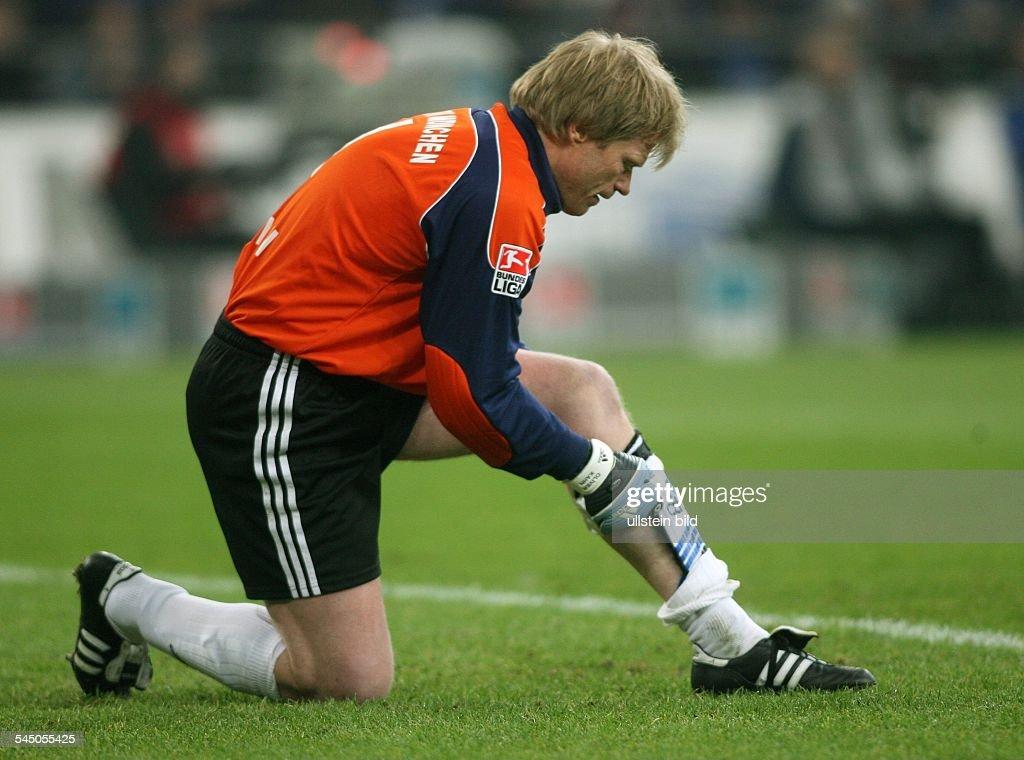 Oliver Kahn Football Goalkeeper FC Bayern Munich Germany kneeling on the pitch adjusting his shin guard