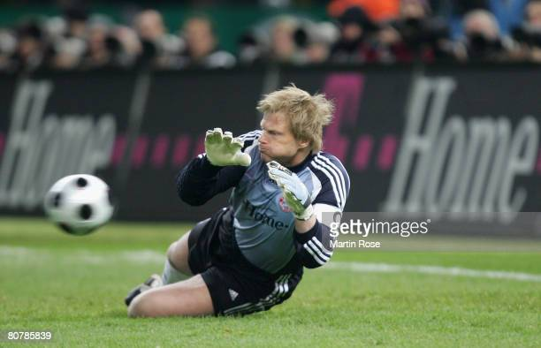 Oliver Kahn goalkeeper of Munich saves the ball during the DFB Cup Final between Borussia Dortmund and Bayern Munich at the Olympic stadium on April...
