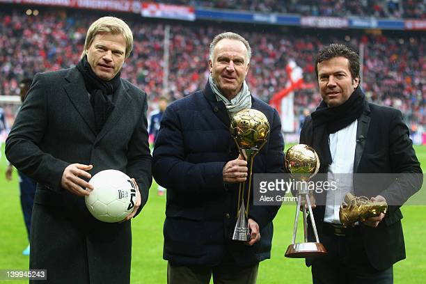 Oliver Kahn KarlHeinz Rummenigge and Lothar Matthaeus pose with exhibition items for the new Bayern Muenchen museum prior to the Bundesliga match...
