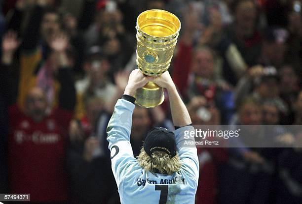 Oliver Kahn of Bayern Munich celebrates with the trophy after winning the DFB German Cup final against Bayern Munich and Eintracht Frankfurt at the...
