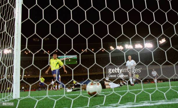 Oliver Kahn of Germany is beaten as Ronaldo of Brazil scores the opening goal during the Germany v Brazil World Cup Final match played at the...