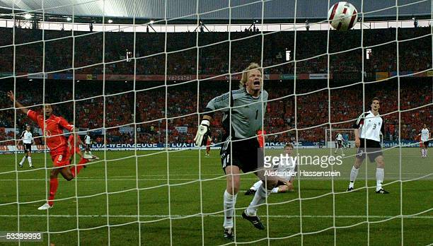 Oliver Kahn of Germany looks on as he concedes a goal during the international friendly match between Netherlands and Germany at the De Kuip Stadium...