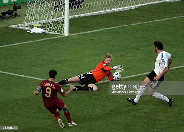 Oliver Kahn the German goalkeeper saves from Pauleta of Portugal during the FIFA World Cup Germany 2006 Third Place Playoff match between Germany and...