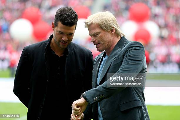 Oliver Kahntalsk to Michael Ballack prior to the Bundesliga match between FC Bayern Muenchen and 1 FSV Mainz 05 at the Allianz Arena on May 23 2015...