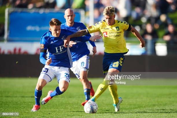 Oliver Kjaergaard of Lyngby BK and Jan Kliment of Brondby IF compete for the ball during the Danish Alka Superliga match between Lyngby BK and...
