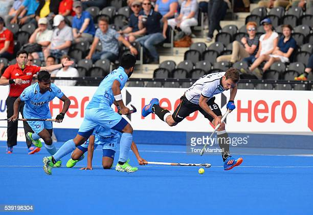 Oliver Korn of Germany is tackled by of India during the FIH Men's Hero Hockey Champions Trophy 2016 Day One match between Germany and India at Queen...