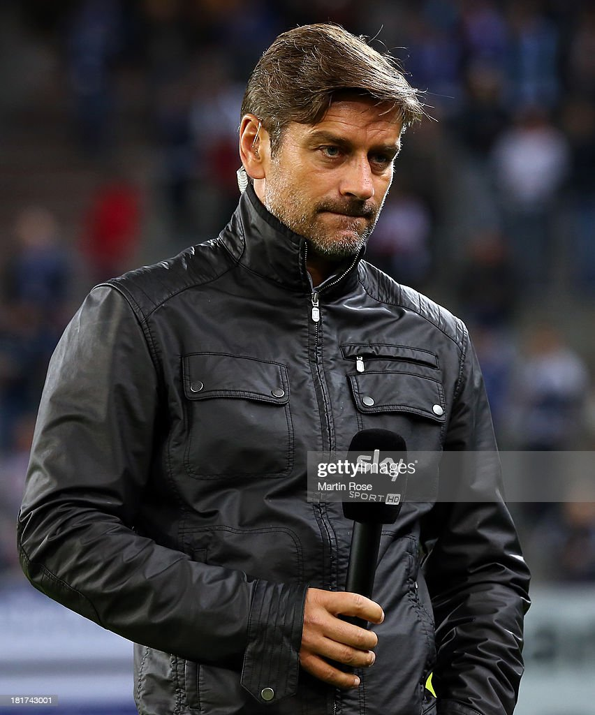 Oliver Kreuzer, sport director of Hamburg reacts before the DFB Cup second round match between Hamburger SV and Greuther Fuerth at Imtech Arena on September 24, 2013 in Hamburg, Germany.