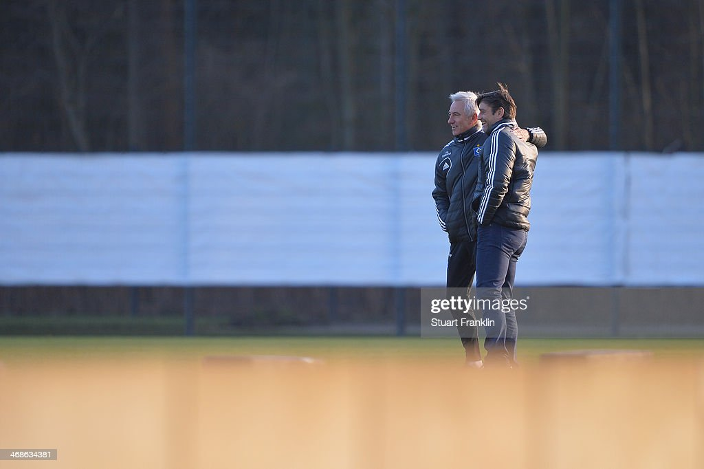 Oliver Kreuzer, sports director of Hamburger SV greets head coach Bert van Marwijk during the training session of Hamburger SV on February 11, 2014 in Hamburg, Germany.