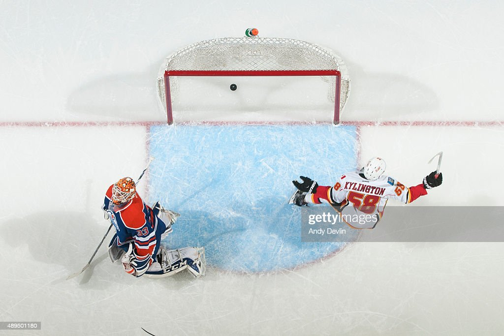 Oliver Kylington #58 of the Calgary Flames scores a goal on Cam Talbot #33 of the Edmonton Oilers on September 21, 2015 at Rexall Place in Edmonton, Alberta, Canada.