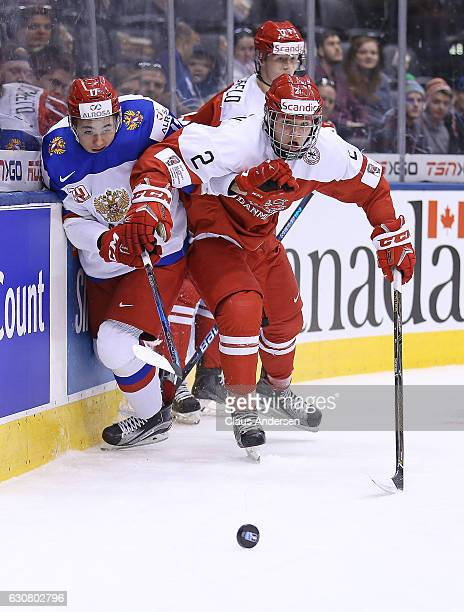 Oliver Larsen of Team Denmark skates agains German Rubtsov of Team Russia during a QuarterFinal game at the 2017 IIHF World Junior Hockey...