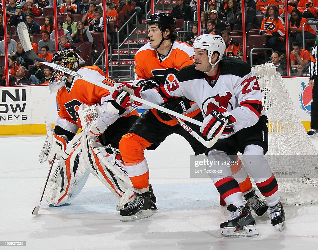 <a gi-track='captionPersonalityLinkClicked' href=/galleries/search?phrase=Oliver+Lauridsen&family=editorial&specificpeople=7228844 ng-click='$event.stopPropagation()'>Oliver Lauridsen</a> #38 of the Philadelphia Flyers battles with David Clarkson #23 of the New Jersey Devils in front of Flyers goaltender <a gi-track='captionPersonalityLinkClicked' href=/galleries/search?phrase=Ilya+Bryzgalov&family=editorial&specificpeople=2285430 ng-click='$event.stopPropagation()'>Ilya Bryzgalov</a> #30 on April 18, 2013 at the Wells Fargo Center in Philadelphia, Pennsylvania.