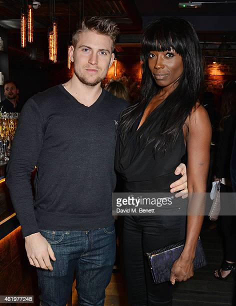Oliver Lee and Lorraine Pascale attend the Jinjuu launch dinner Kingly Street at Jinjuu on January 22 2015 in London England