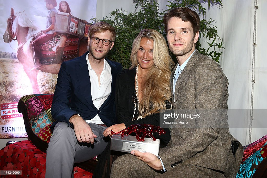 Oliver Luehr, Olivia Schoenhofen and Thomas Bentz with the award at KARE Design at the New Faces Award Fashion 2013 at Rheinterrasse on July 22, 2013 in Duesseldorf, Germany.