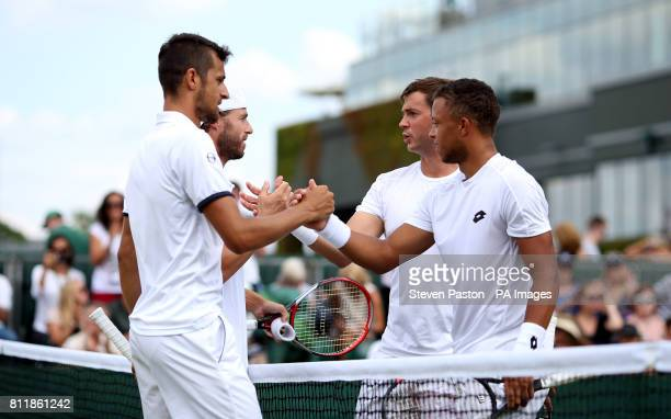 Oliver Marach and Mate Pavic shake hands with Marcus Willis and Jay Clarke after their doubles match on day seven of the Wimbledon Championships at...
