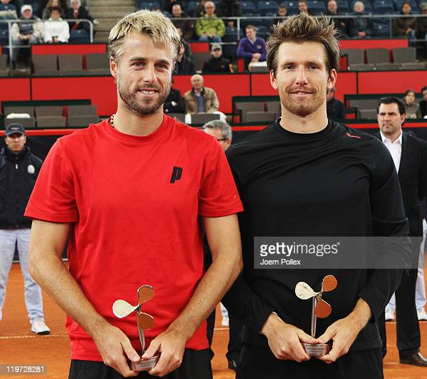 Oliver Marach of Austria and Alexander Peya of Austria are celebrating with their cups after winning their semi doubles final match against Frantisek...