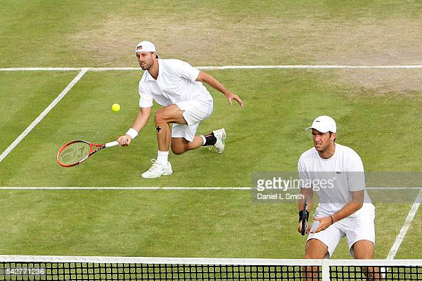 Oliver Marach of Austria and Fabrice Martin of France attack at the net during their men's doubles semifinal match against Ivan Dodig of Croatia and...