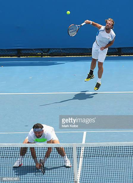 Oliver Marach of Austria and Florin Mergea of Romania in action in their first round doubles match against Santiago Gonzalez of Mexico and Scott...