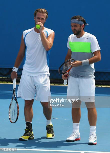 Oliver Marach of Austria and Florin Mergea of Romania talk tactics in their first round doubles match against Santiago Gonzalez of Mexico and Scott...