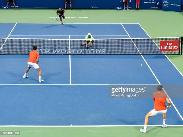 Oliver Marach of Austria and Mate Pavic of Croatia compete against PierreHugues Herbert and Nicolas Mahut of France in a doubles match during day...
