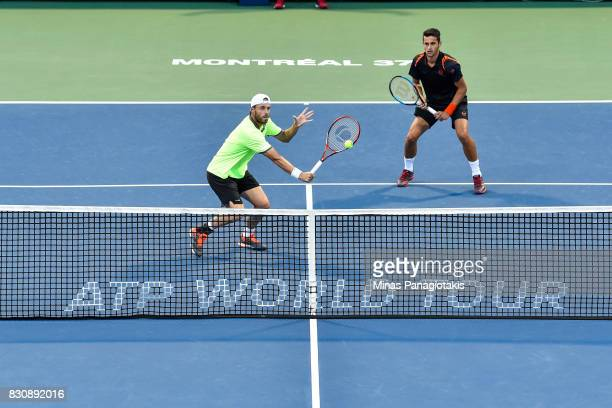 Oliver Marach of Austria and Mate Pavic of Croatia compete in a doubles match against PierreHugues Herbert and Nicolas Mahut of France during day...