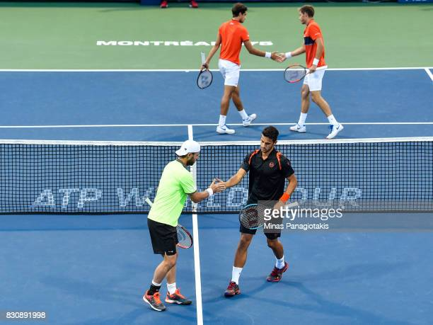 Oliver Marach of Austria and Mate Pavic of Croatia encourage one another as their opponents PierreHugues Herbert and Nicolas Mahut of France do the...