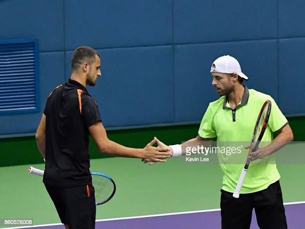 Oliver Marach of Austria and Mate Pavic of Croatia in action in the match between Wu Di of China and Wu Yibing of China and Oliver Marach of Austria...