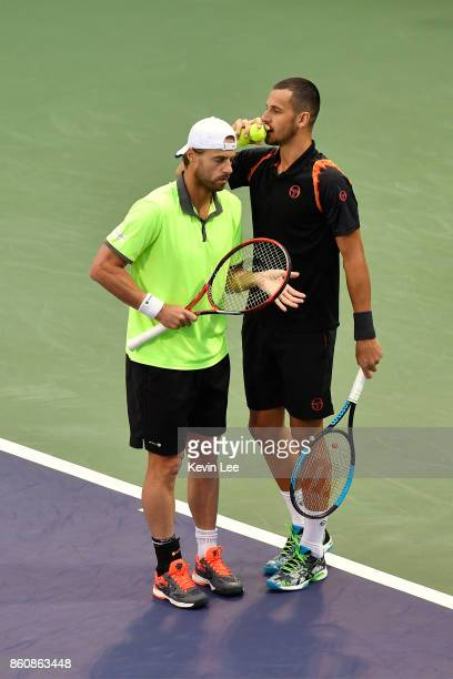 Oliver Marach of Austria and Mate Pavic of Croatia in action in the match between JeanJulien Rojer of Netherland and Horia Tecau of Romania and...