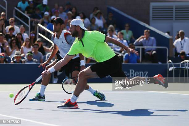 Oliver Marach of Austria and Mate Pavic of Croatia return a shot against Bob Bryan and Mike Bryan of the United States during their third round Men's...
