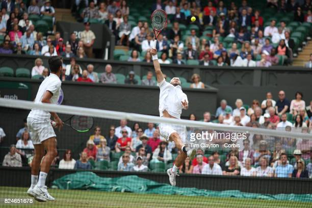 Oliver Marach of Austria in action along with Mate Pavic of Croatian in the Men's Doubles Final on Center Court during the Wimbledon Lawn Tennis...