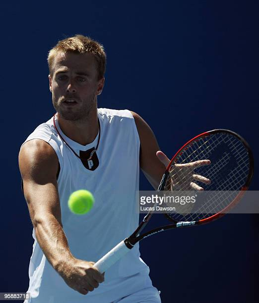 Oliver Marach of Austria plays a backhand in his first round doubles match with Lukasz Kubot of Poland against Juan Ignacio Chela of Argentina and...