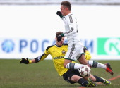 Oliver Markoutz of Bayern Muenchen battles for the ball with Ilya Pomazun keeper of Moscow during the UEFA Youth League match between CSKA MOscow and...