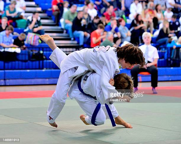 Oliver Marshall throws Jacob Atkins for ippon in the u42 kgs boys category during the day 1 junior session of the Kent International held at Crystal...