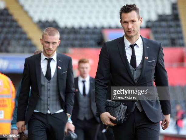 Oliver McBurnie and Erwin Mulder of Swansea City arrive prior to the game during the Premier League match between Swansea City and Brighton and Hove...