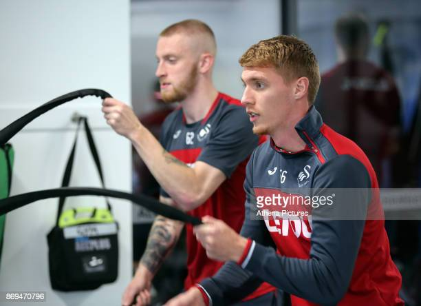Oliver McBurnie and Jay Fulton of Swansea exercise in the gym during the Swansea City Training at The Fairwood Training Ground on November 01 2017 in...