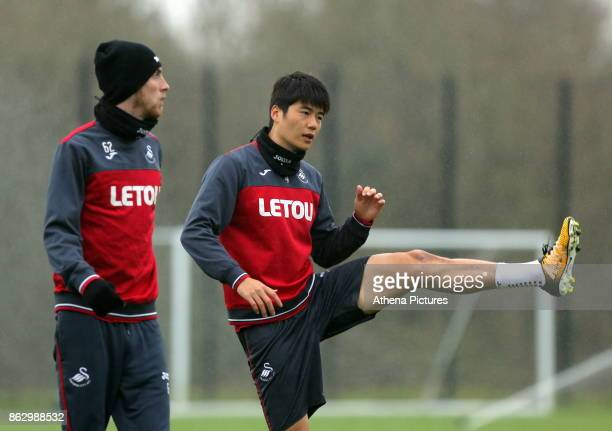 Oliver McBurnie and Ki SungYueng in action during the Swansea City Training at The Fairwood Training Ground on October 18 2017 in Swansea Wales