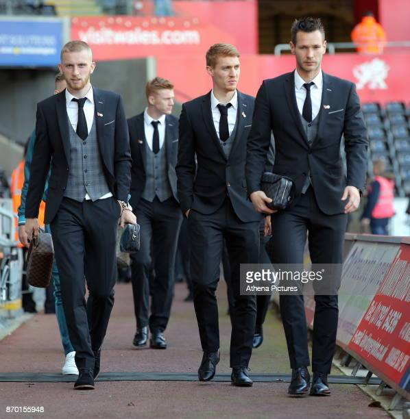 Oliver McBurnie Jay Fulton and Erwin Mulder of Swansea City arrive prior to the game during the Premier League match between Swansea City and...