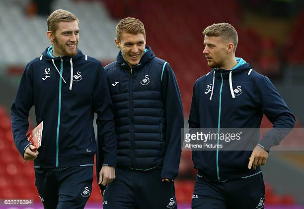 Oliver McBurnie Jay Fulton and Stephen Kingsley of Swansea City prior to kick off of the Premier League match between Liverpool and Swansea City at...