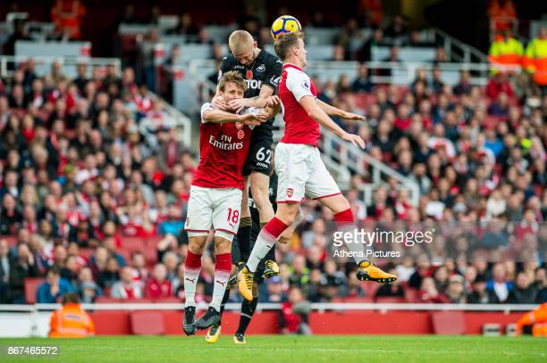 Oliver McBurnie jumps for the ball during the Premier League match between Arsenal and Swansea City at Emirates stadium on October 28 2017 in London...