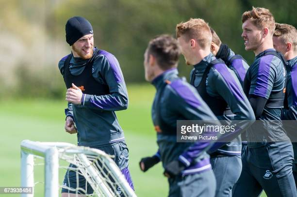 Oliver McBurnie leads the team mates during training the Swansea City training session at The Fairwood training Ground on November 16 2016 in Swansea...